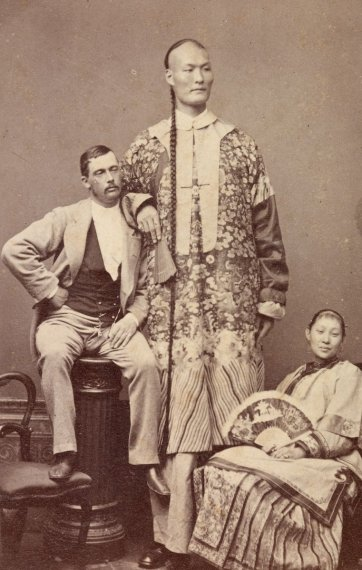 Chang the Chinese giant with his seated wife Kin Foo with fan and manager, c. 1871 by Alexander McDonald