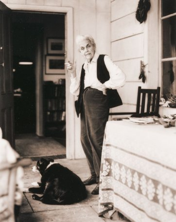 Nora Heysen with her dog standing outside her home, Hunters Hill, Sydney, 2000 by Sage