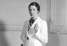 Amy Johnson wearing a woollen suit from the collection of flight clothes designed by Madame Schiaparelli for her solo flight from London to Cape Town, 1938 unknown photographer