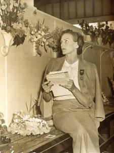 Helen Blaxland judging flower arrangements, c. 1940s photographer unknown