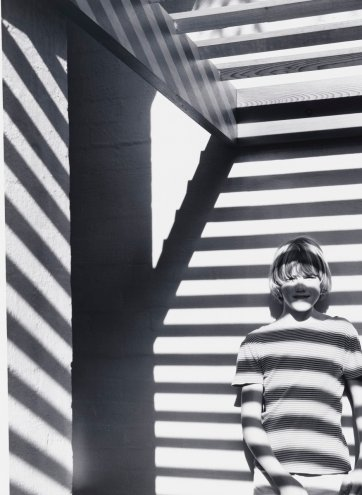 Matthew Moore with pergola shadows, McMahon's Point, Sydney, 1978 (printed 2000) David Moore
