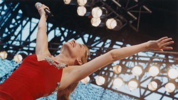Untitled#15 from Tour of Duty series (Kylie Minogue performs at Tour of Duty concert at Dili Stadium, East Timor, 21 December 1999), 1999-2000 Matthew Sleeth