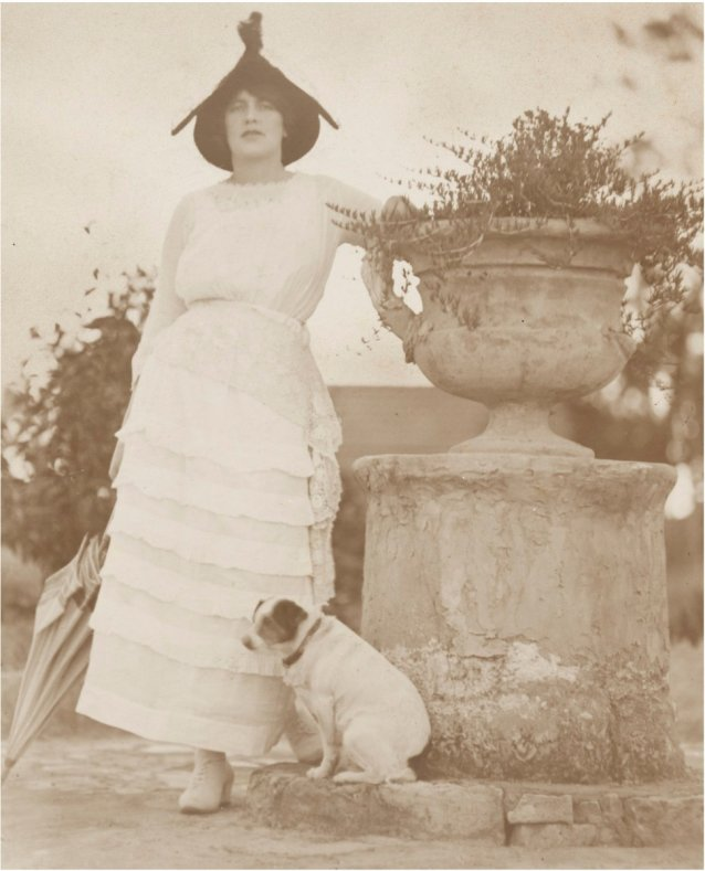 Rose Lindsay in garden at Springwood with Peter the fox terrier