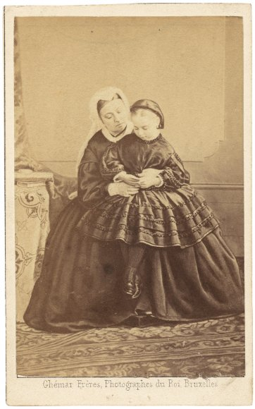 Queen Victoria and Princess Beatrice, looking at a carte de visite of Prince Albert