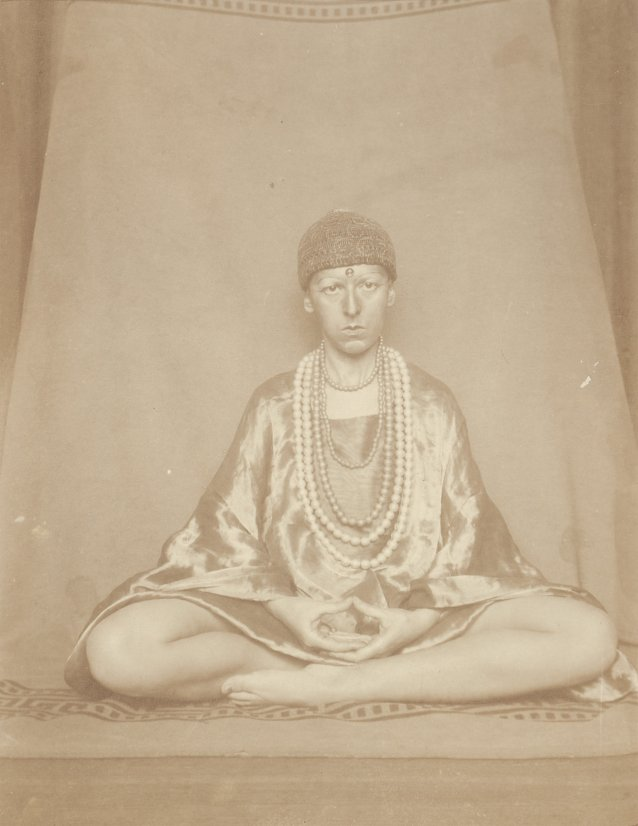 Self portrait (seated cross legged like Buddha) 1927 by Claude Cahun (Lucy Schwob)