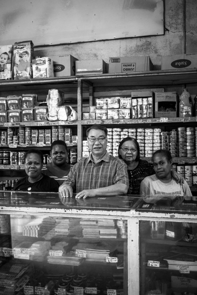 Trade store owners Michael and Justine Cheung and staff, Honiara by Sean Davey