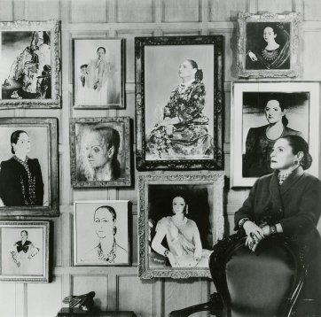 Helena Rubinstein with an artificial photomontage of part of her portrait collection, c. 1957