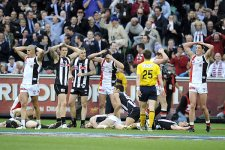 """Players react after the siren sounds at the end of the 2010 AFL grand final."" Photo by Sebastian Costanzo for the Sydney Morning Herald."