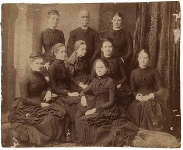 Edward Ogilvie and his eight daughters, c. 1886