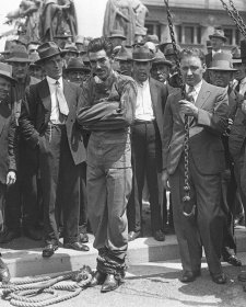 Murray frees himself from straightjacket in public, 1928 by Sam Hood