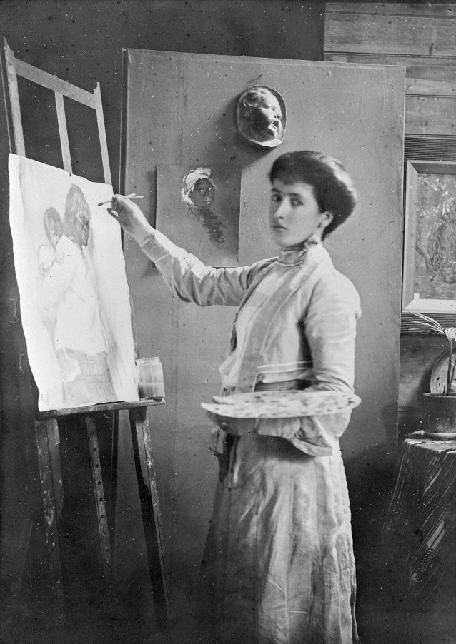 Portrait of Frances Mary Hodgkins painting at an easel in her studio in Bowen Street, 1900
