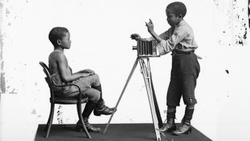 Albert Jonas and John Xiniwe of The African Choir, 1891 London Stereoscopic Co.