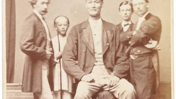 Chang the Chinese giant in European dress with Chinese boy and three European men, one of whom is his manager, c. 1871 Archibald McDonald