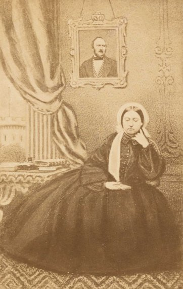 Queen Victoria in mourning, with a portrait of Prince Albert, c. 1862 an unknown artist