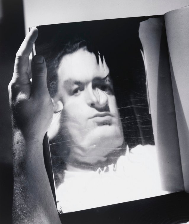 David Potts reflected in a magazine page
