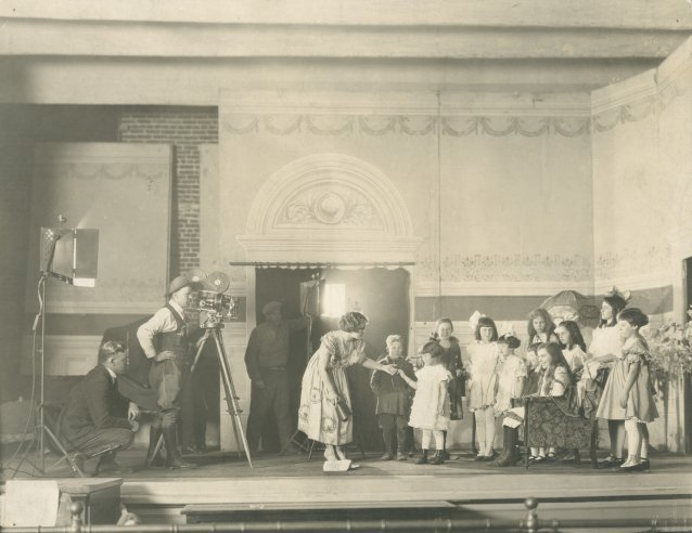 Louise Lovely with children during production of A Day in the Studio, c.1922 Unknown photographer