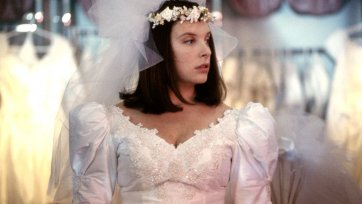 Toni Collette as Muriel trying on a wedding dress by Robert McFarlane, Muriel's Wedding, 1994