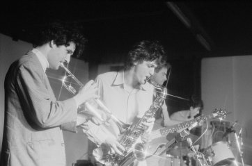 The Lighthouse Keepers, ANU Union, Canberra, 1983. Steven Williams (drums), Blue (Michael Dalton- bass), Hairy (Stephen O'Neil- sax), Alex Hamilton (trumpet) 'pling