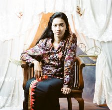 Potret diri di depan kelambu terbuka (Self portrait before the open mosquito net), 2009 by Herra Pahlasari