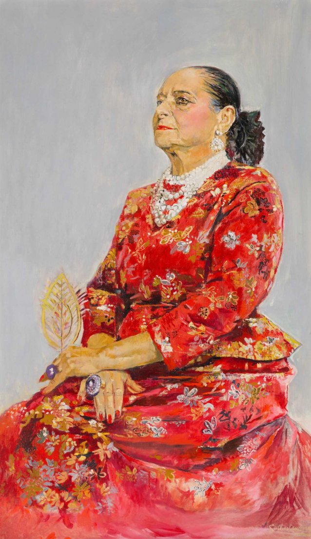 Helena Rubinstein in a red brocade Balenciaga gown