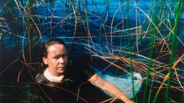After Ophelia: Fiona Foley at Lake Mackenzie, Fraser Island (Referencing Ophelia by John Everett Millais), 1994 Juno Gemes