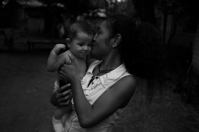 Connie and Philippe, White River, Honiara by Sean Davey