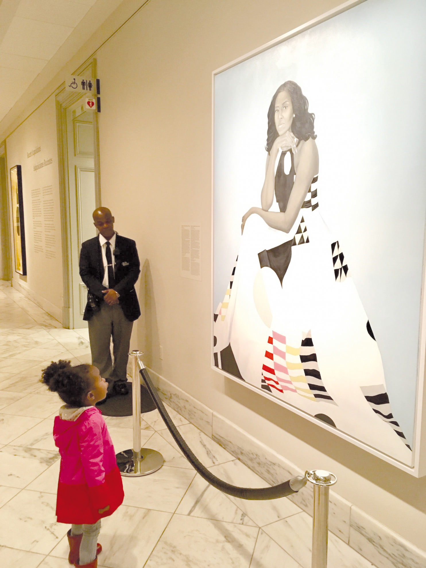 Parker Curry viewing portrait of Michelle Obama Image: Ben Hines